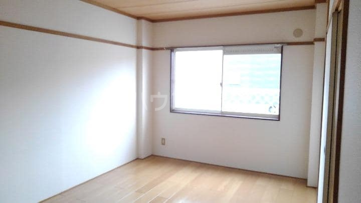 サニーヒルズ 01050号室のベッドルーム