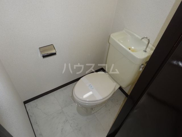 スイートム塚原 101号室のトイレ