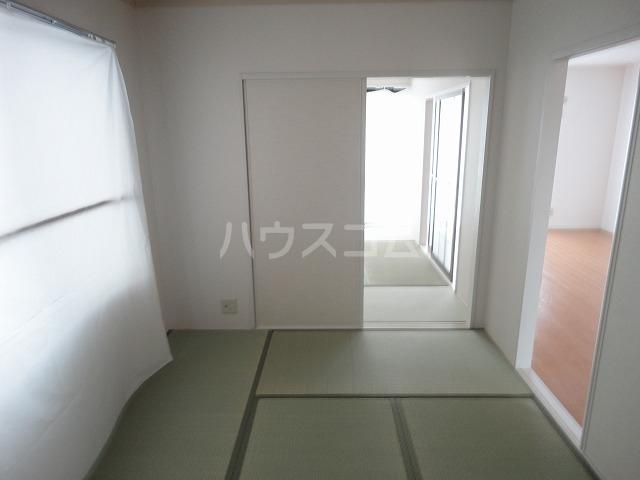 メイプル笹川 202号室の居室