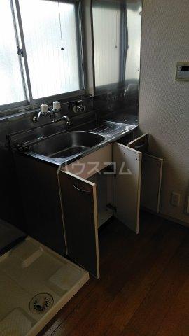 第六美多摩 103号室のキッチン