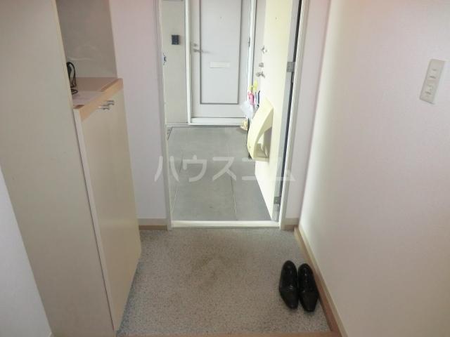 ロジュマンイズミF、G棟 G201号室の玄関