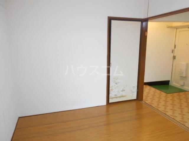 鈴木ビルデンス 104号室のベッドルーム