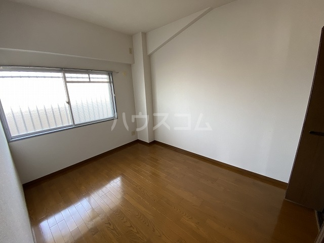 ラフィーネ六名 402号室のベッドルーム