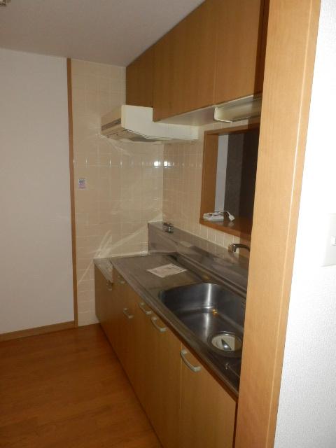 サンパークSHIMADA 203号室のキッチン